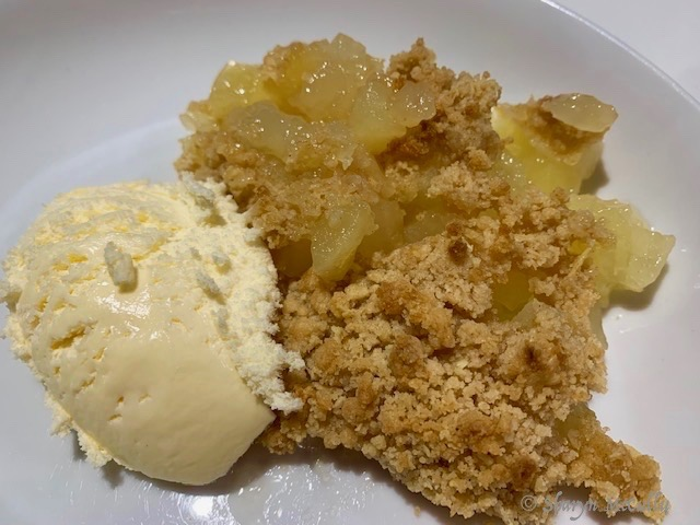 Apple Crumble Is An Easy Concoction of Stewed Apples With A Crumbly Biscuit Top Served With Ice-cream.