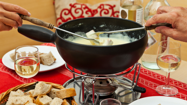Swiss cheese Fondu in A Fondu Cooking Bowl Is A Cheese Sauce That You Dunk Food, Like Bread Pieces, In The Sauce Then Eat.