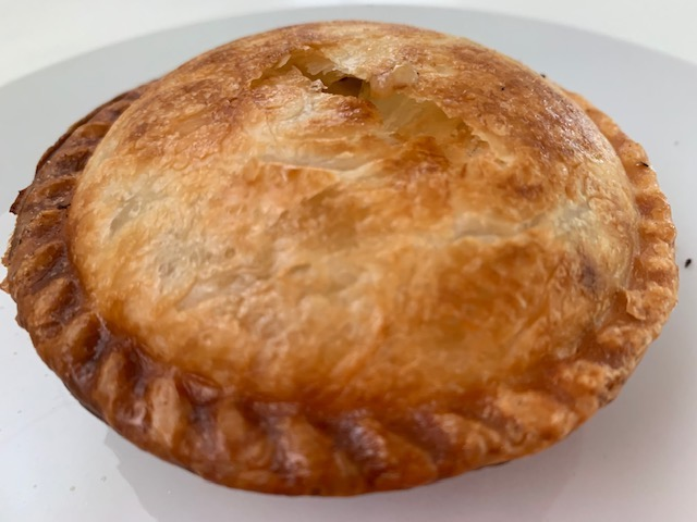 Pie. Golden Pastry Cooked In A Circle With Yummy Mince Meat Inside.