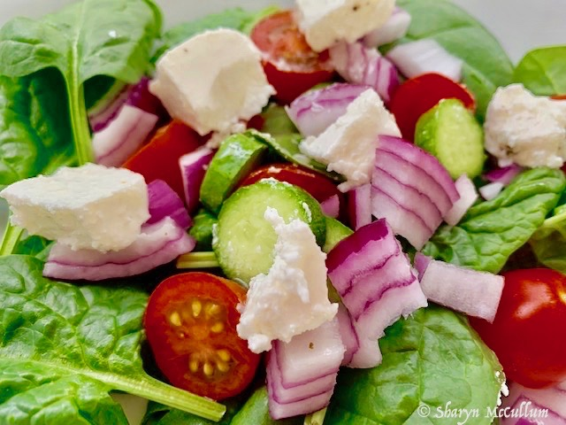 Greek Salad Made With Lettuce, Tomato, Red Onion, Cucumber And Feta Cheese.