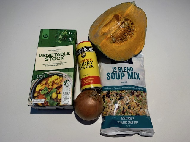 Ingredients For Curry Lentil and Pumpkin Soup. A Pumpkin, Soup Mix, Onion, Curry Powder And Vegetable Stock.