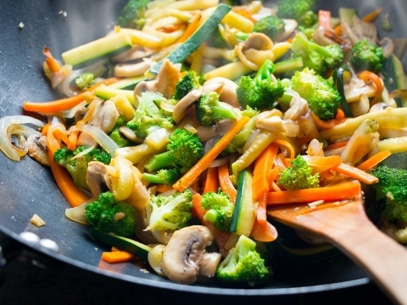 Vegetable Stir Fry. Mushrooms, Carrots, Onion, Broccoli all Cut into Similar Sizes for Easy Cooking.